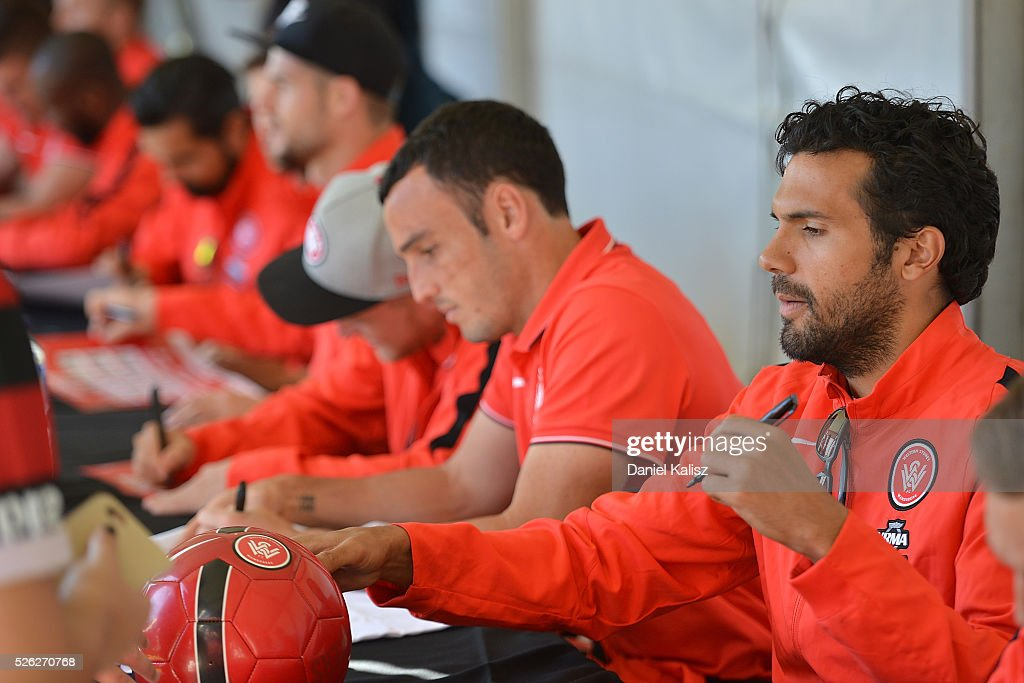 <a gi-track='captionPersonalityLinkClicked' href=/galleries/search?phrase=Nikolai+Topor-Stanley&family=editorial&specificpeople=2517636 ng-click='$event.stopPropagation()'>Nikolai Topor-Stanley</a> of the Wanderers signs an autograph for a fan during the A-League Grand Final Fan Day at Bonython Park on April 30, 2016 in Adelaide, Australia.