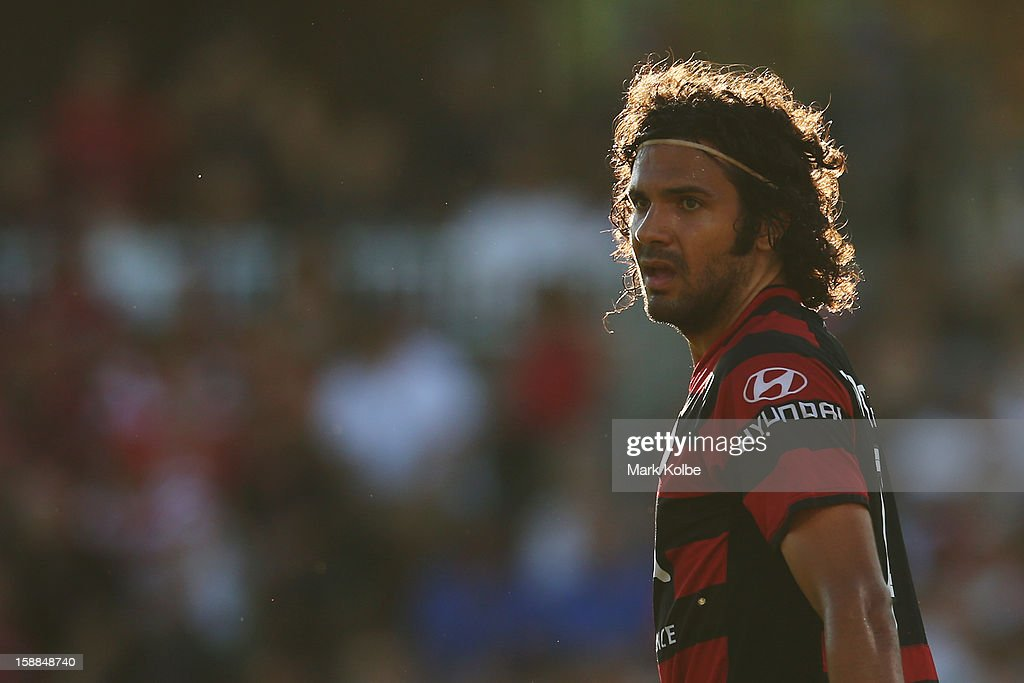 Nikolai Topor-Stanley of the Wanderers watches on during the round 14 A-League match between the Western Sydney Wanderers and the Melbourne Victory at Parramatta Stadium on January 1, 2013 in Sydney, Australia.
