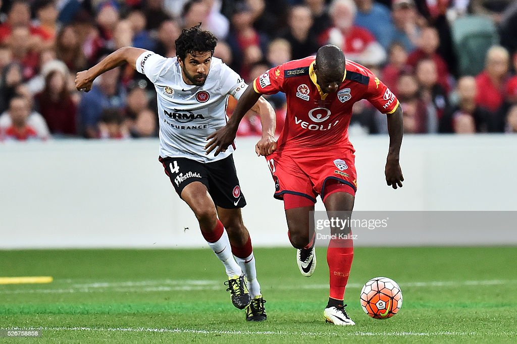 Nikolai Topor-Stanley of the Wanderes competes for the ball with Bruce Djite of United during the 2015/16 A-League Grand Final match between Adelaide United and the Western Sydney Wanderers at Adelaide Oval on May 1, 2016 in Adelaide, Australia.
