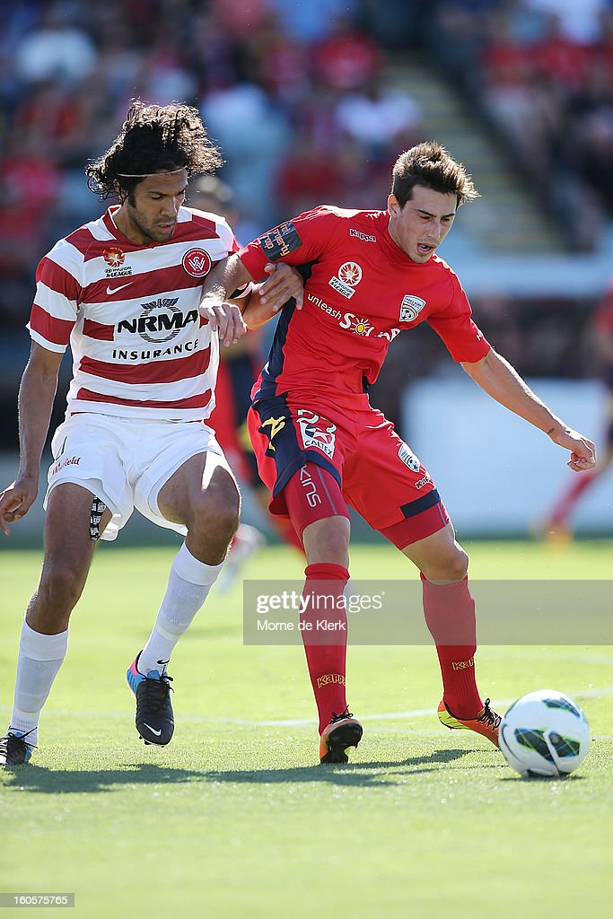 Nikolai Topor-Stanley of Western Sydney competes with Evan Kostopoulos of Adelaide during the round 19 A-League match between Adelaide United and the Western Sydney Wanderers at Hindmarsh Stadium on February 3, 2013 in Adelaide, Australia.