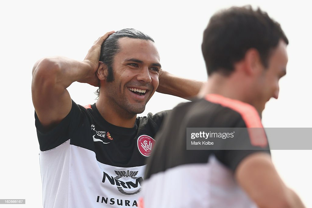 Nikolai Topor-Stanley shares a laugh with Mark Bridge during a Western Sydney Wanderers A-League training session at Blacktown International Sportspark on February 26, 2013 in Sydney, Australia.