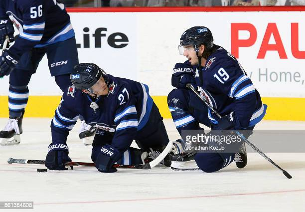 Nikolaj Ehlers and Nic Petan of the Winnipeg Jets take part in the pregame warm up prior to NHL action against the Carolina Hurricanes at the Bell...