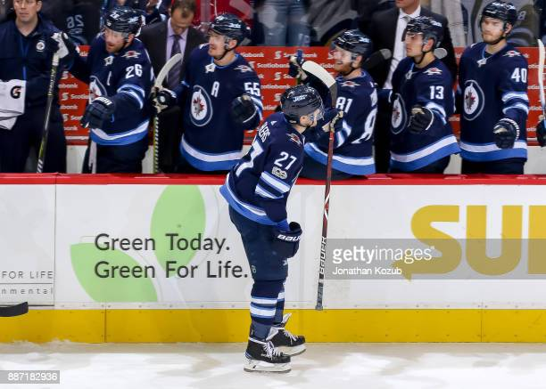 Nikolaj Ehlers of the Winnipeg Jets celebrates a third period goal against the Vegas Golden Knights with teammates at the bench at the Bell MTS Place...
