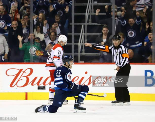 Nikolaj Ehlers of the Winnipeg Jets celebrates after scoring a third period goal against the Carolina Hurricanes at the Bell MTS Place on October 14...
