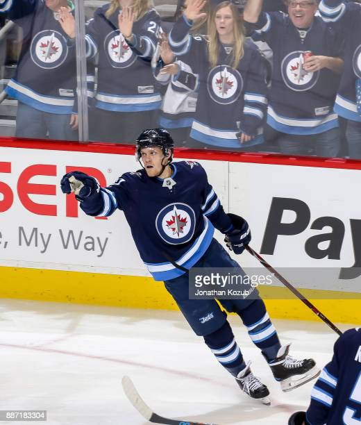 Nikolaj Ehlers of the Winnipeg Jets celebrates after scoring a third period goal against the Vegas Golden Knights at the Bell MTS Place on December 1...