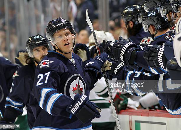 Nikolaj Ehlers of the Winnipeg Jets celebrates his first period goal against the Minnesota Wild with teammates at the bench at the MTS Centre on...