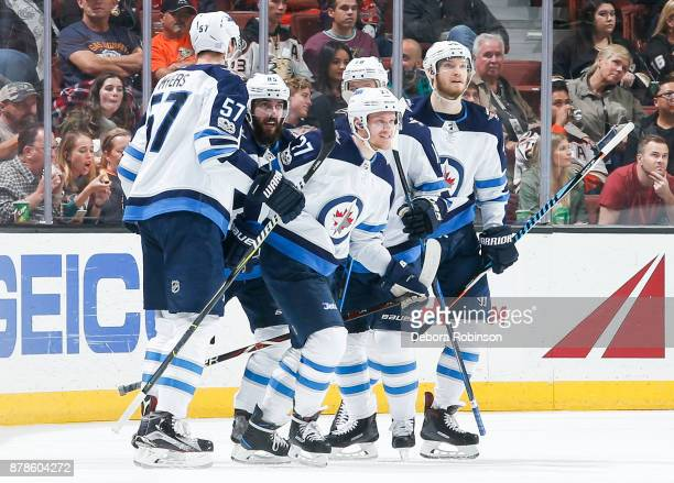 Nikolaj Ehlers of the Winnipeg Jets celebrates his second firstperiod goal with Tyler Myers Mathieu Perreault Bryan Little and Joel Armia during the...