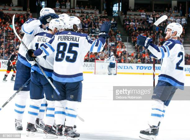 Nikolaj Ehlers of the Winnipeg Jets joins Bryan Little Mathieu Perreault and teammates to celebrate Little's secondperiod goal during the game...