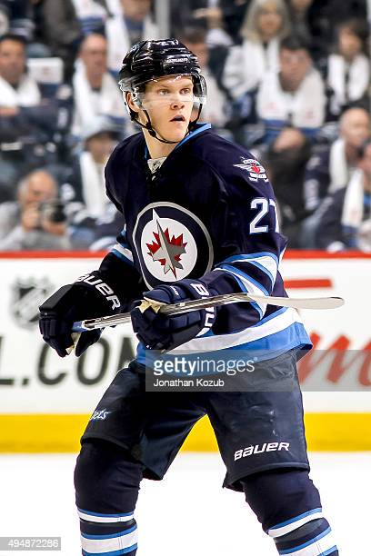 Nikolaj Ehlers of the Winnipeg Jets keeps an eye on the play during first period action against the Minnesota Wild at the MTS Centre on October 25...