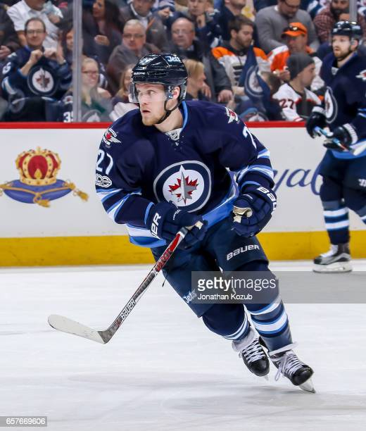 Nikolaj Ehlers of the Winnipeg Jets keeps an eye on the play during second period action against the Philadelphia Flyers at the MTS Centre on March...