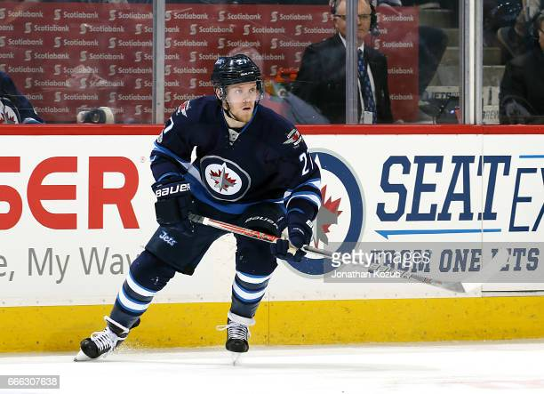Nikolaj Ehlers of the Winnipeg Jets keeps an eye on the play during second period action against the Nashville Predators at the MTS Centre on April 8...