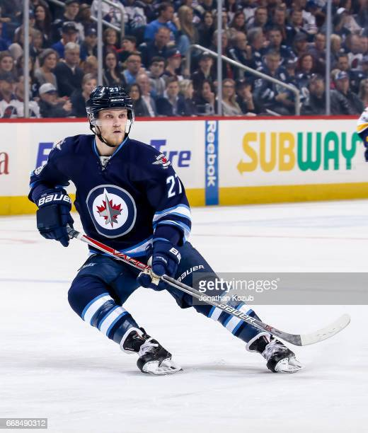 Nikolaj Ehlers of the Winnipeg Jets keeps an eye on the play during first period action against the Nashville Predators at the MTS Centre on April 8...
