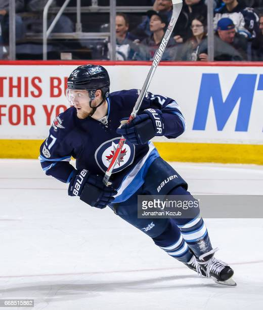 Nikolaj Ehlers of the Winnipeg Jets keeps an eye on the play during third period action against the Nashville Predators at the MTS Centre on April 8...