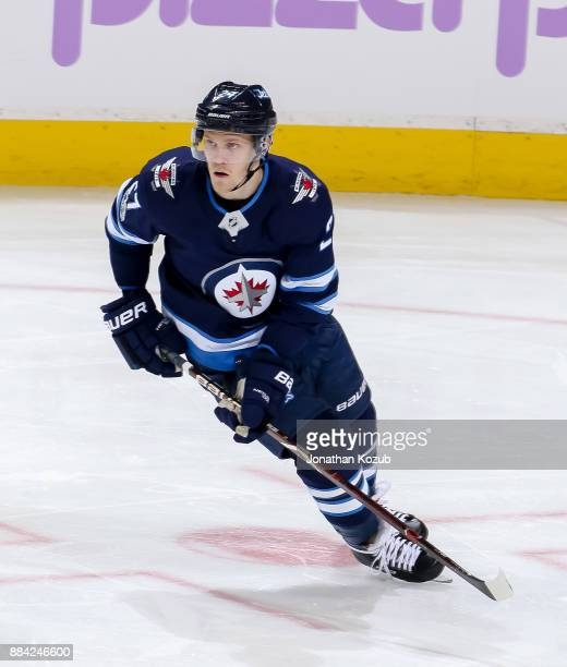 Nikolaj Ehlers of the Winnipeg Jets keeps an eye on the play during third period action against the Minnesota Wild at the Bell MTS Place on November...