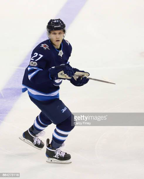 Nikolaj Ehlers of the Winnipeg Jets keeps an eye on the play during second period action against the Minnesota Wild at the Bell MTS Place on November...