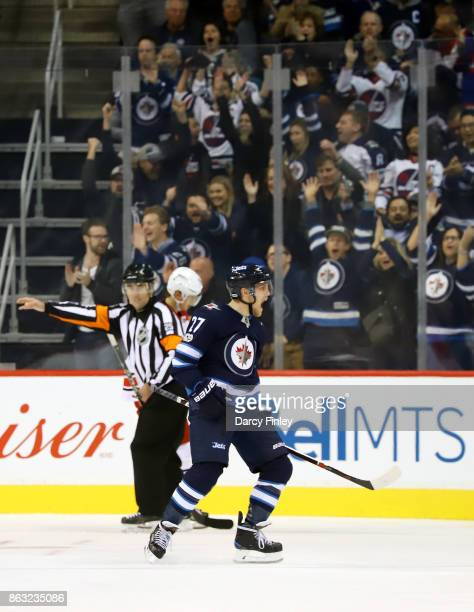 Nikolaj Ehlers of the Winnipeg Jets lets out a roar after scoring a third period goal against the Carolina Hurricanes at the Bell MTS Place on...
