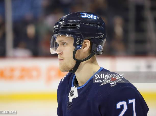 Nikolaj Ehlers of the Winnipeg Jets looks on during second period action against the New Jersey Devils at the Bell MTS Place on November 18 2017 in...