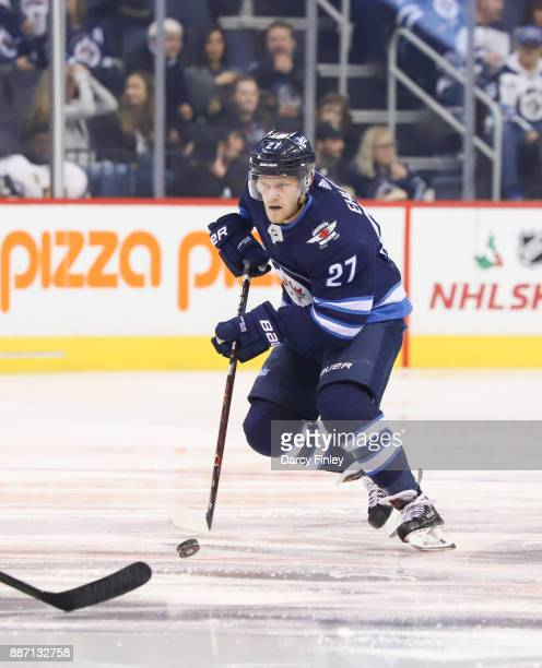 Nikolaj Ehlers of the Winnipeg Jets plays the puck down the ice during third period action against the Vegas Golden Knights at the Bell MTS Place on...