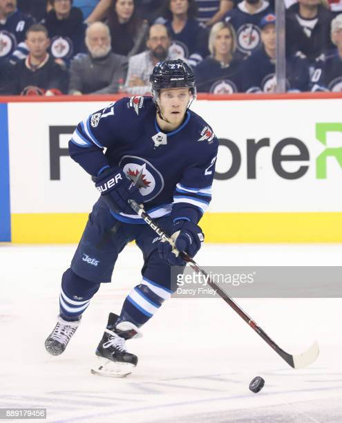 Nikolaj Ehlers of the Winnipeg Jets plays the puck down the ice during first period action against the Ottawa Senators at the Bell MTS Place on...