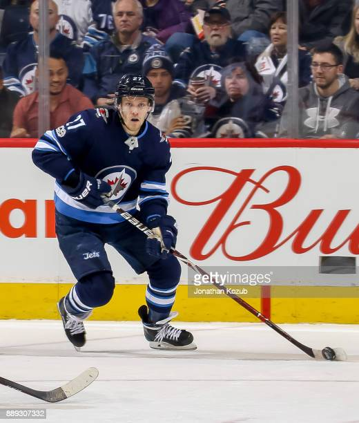Nikolaj Ehlers of the Winnipeg Jets plays the puck during third period action against the Ottawa Senators at the Bell MTS Place on December 3 2017 in...