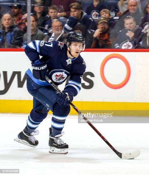 Nikolaj Ehlers of the Winnipeg Jets plays the puck up the ice during third period action against the New Jersey Devils at the Bell MTS Place on...
