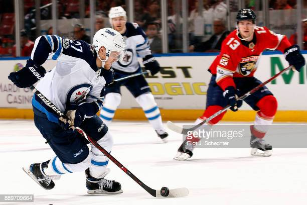 Nikolaj Ehlers of the Winnipeg Jets skates with the puck against the Florida Panthers at the BBT Center on December 7 2017 in Sunrise Florida