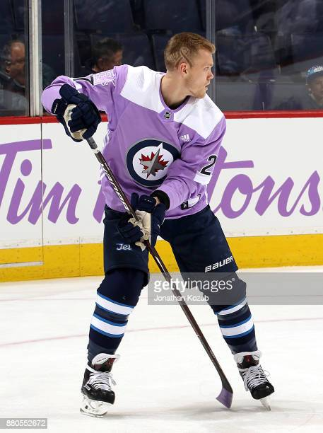 Nikolaj Ehlers of the Winnipeg Jets sports a lavender jersey and a special haircut during the pregame warm up in support of Hockey Fights Cancer...