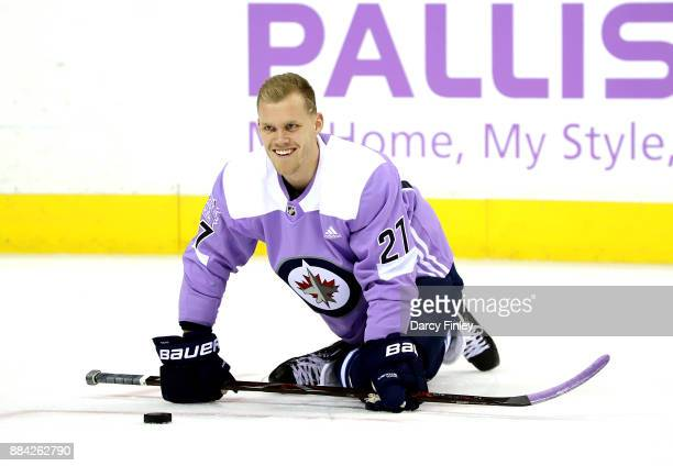 Nikolaj Ehlers of the Winnipeg Jets sports a lavender jersey during the pregame warm up in support of Hockey Fights Cancer Night against the...