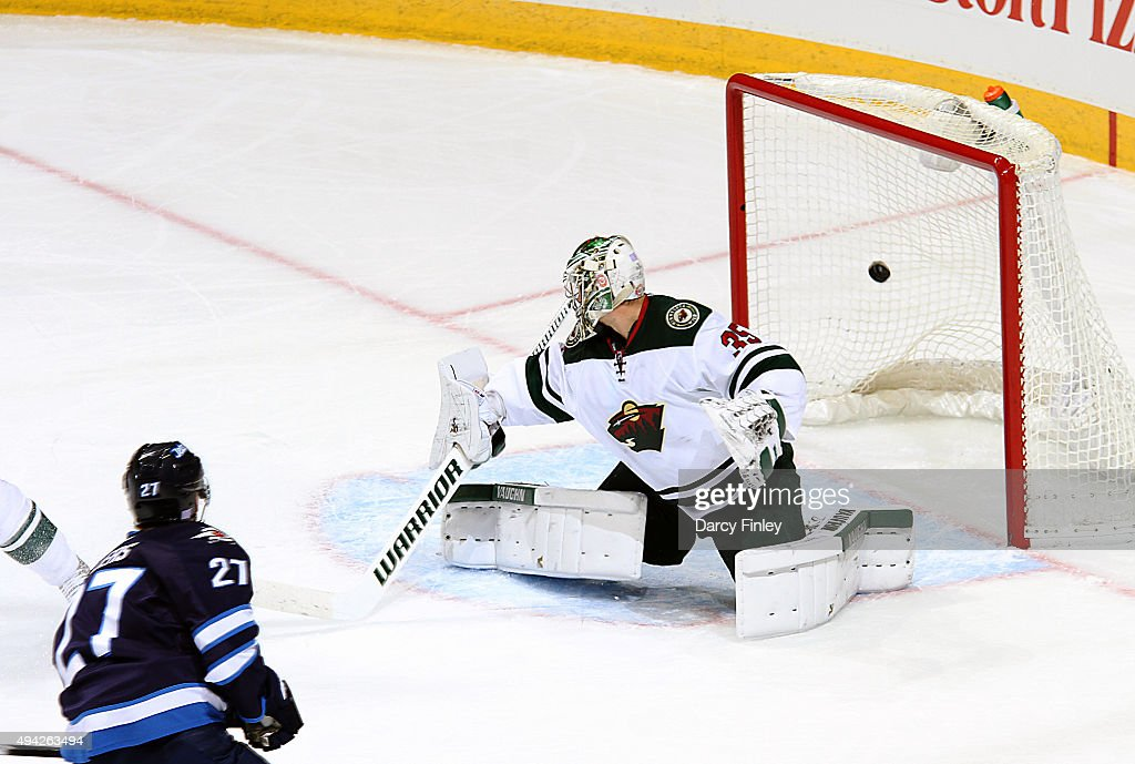 Nikolaj Ehlers #27 of the Winnipeg Jets watches as his shot flies into the net behind goaltender Darcy Kuemper #35 of the Minnesota Wild for a first period goal at the MTS Centre on October 25, 2015 in Winnipeg, Manitoba, Canada.