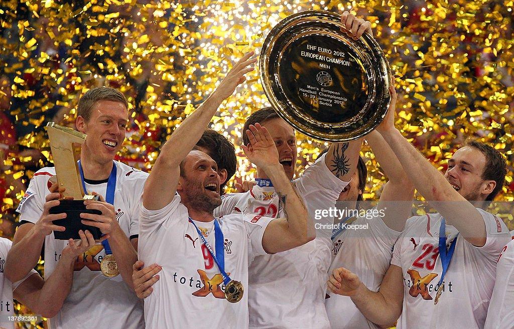 Nikolaj Markussen, Lars Christiansen, Kasper Soendergaard Sarup and Henrik Toft Hansen of Denmark lift up the EHF trophy on the podium after winning 21-19 the Men's European Handball Championship final match between Serbia and Denmark at Beogradska Arena on January 29, 2012 in Belgrade, Serbia.