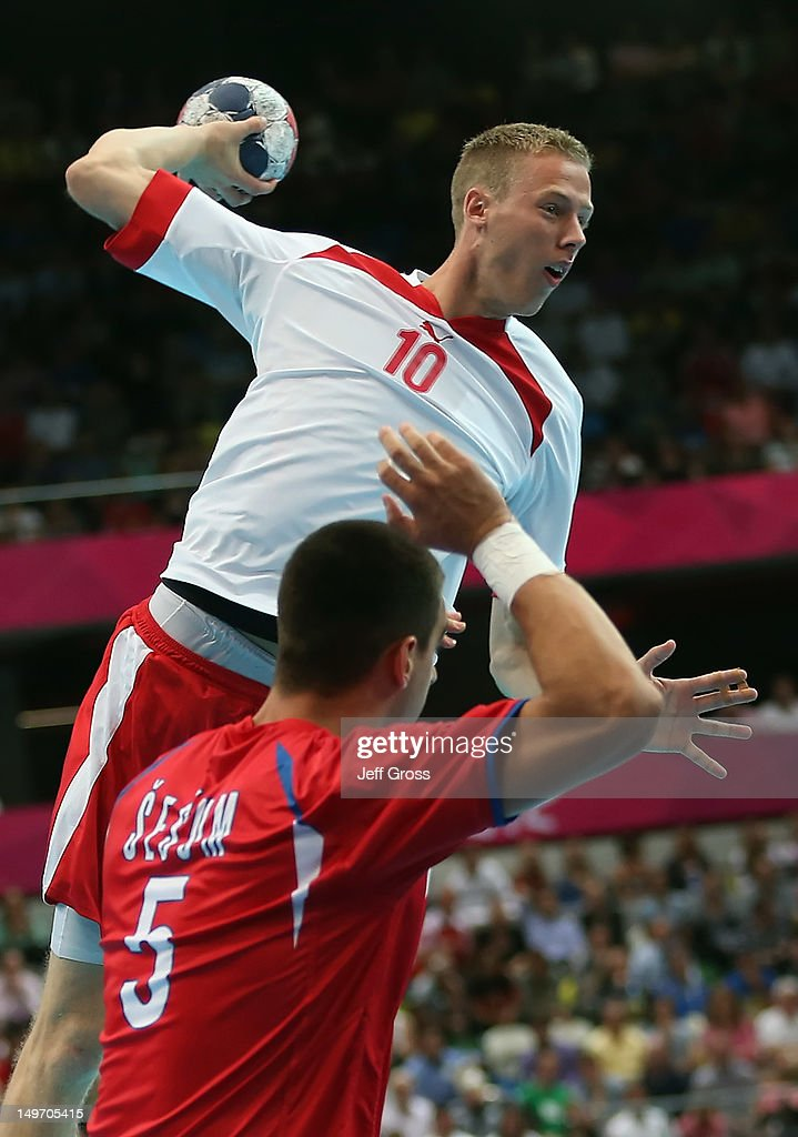 Nikolaj Markussen #10 of Denmark shoots and scores over <a gi-track='captionPersonalityLinkClicked' href=/galleries/search?phrase=Zarko+Sesum&family=editorial&specificpeople=5668700 ng-click='$event.stopPropagation()'>Zarko Sesum</a> #5 of Serbia in the Men's Preliminaries Group B match between Serbia and Denmark on Day 6 of the London 2012 Olympic Games at The Copper Box on August 2, 2012 in London, England.