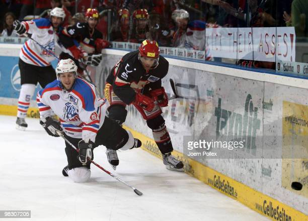 Nikolaus Mondt of Hannover and Bjoern Barta of Nuernberg battle for the puck during the fifth DEL quarter final playoff game between Hannover...