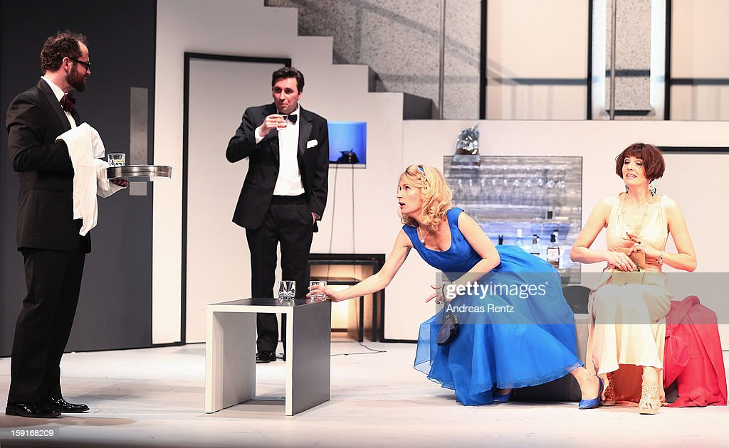 Nikolaus Szentmiklosi, Ivan Vrgoc, Maria Furtwaengler and Nicole Marischka perform during the 'Geruechte...Geruechte...' photo rehearsal at Komoedie am Kurfuerstendamm Theater on January 9, 2013 in Berlin, Germany.