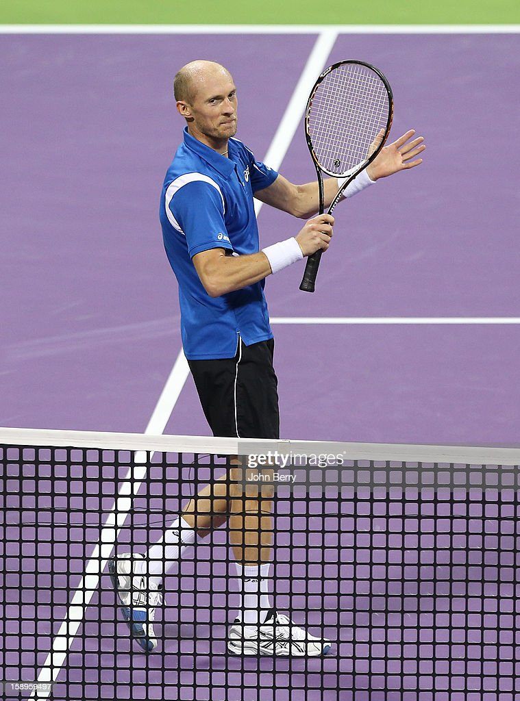 <a gi-track='captionPersonalityLinkClicked' href=/galleries/search?phrase=Nikolay+Davydenko&family=editorial&specificpeople=178192 ng-click='$event.stopPropagation()'>Nikolay Davydenko</a> of Russia celebrates his victory after his semi-final against David Ferrer of Spain in day five of the Qatar Open 2013 at the Khalifa International Tennis and Squash Complex on January 4, 2012 in Doha, Qatar.