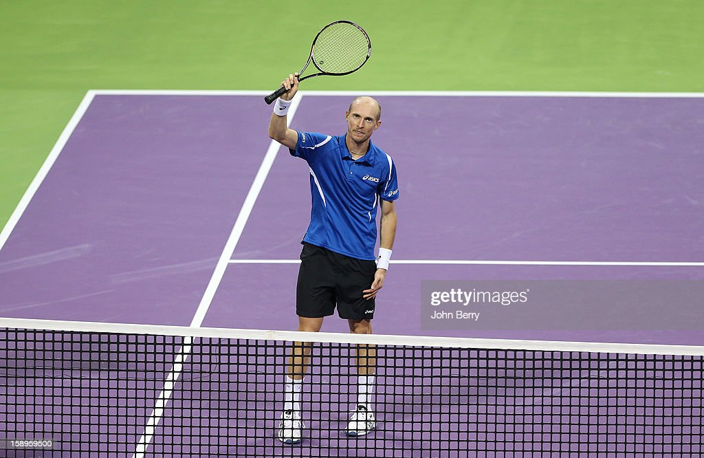 Nikolay Davydenko of Russia celebrates his victory after his semi-final against David Ferrer of Spain in day five of the Qatar Open 2013 at the Khalifa International Tennis and Squash Complex on January 4, 2012 in Doha, Qatar.