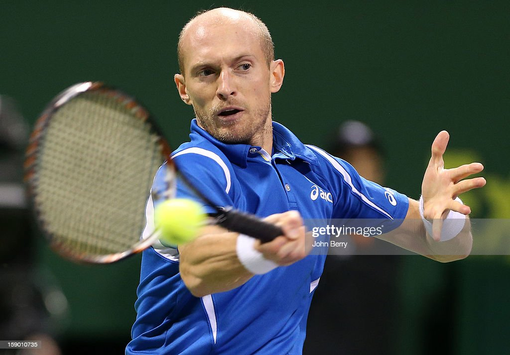 <a gi-track='captionPersonalityLinkClicked' href=/galleries/search?phrase=Nikolay+Davydenko&family=editorial&specificpeople=178192 ng-click='$event.stopPropagation()'>Nikolay Davydenko</a> of Russia plays a forehand during the final against Richard Gasquet of France on day six of the Qatar Open 2013 at the Khalifa International Tennis and Squash Complex on January 5, 2013 in Doha, Qatar.