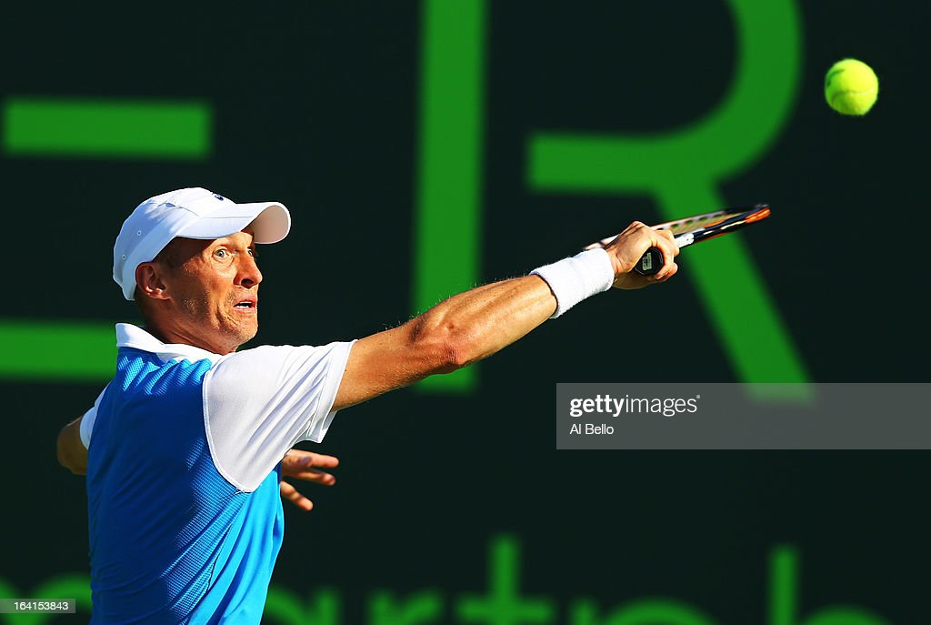 Nikolay Davydenko of Russia returns a shot against during Day 3 of the Sony Open at at the Crandon Park Tennis Center on March 20, 2013 in Key Biscayne, Florida.