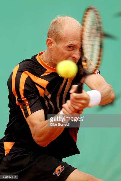 Nikolay Davydenko of Russia returns a shot to Stefano Galvani of Italy during the Men's Singles 1st Round match on day two of the French Open at...