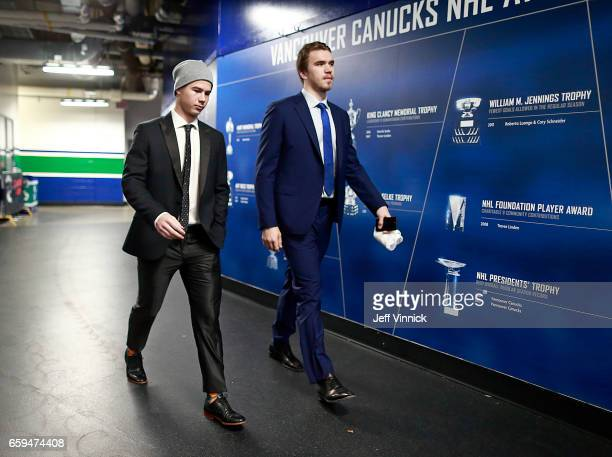Nikolay Goldobin and Nikita Tryamkin of the Vancouver Canucks they walk to the team dressing room before their NHL game against the Anaheim Ducks at...