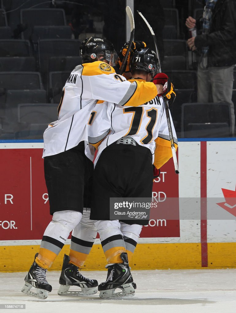 Nikolay Goldobin #71 of the Sarnia Sting is congratulated on his game winning goal in an OHL game against the London Knights on January 1, 2013 at the Budweiser Gardens in London, Canada. The Sting defeated the Knights 6-5 in overtime to snap London's 24 game winning streak.