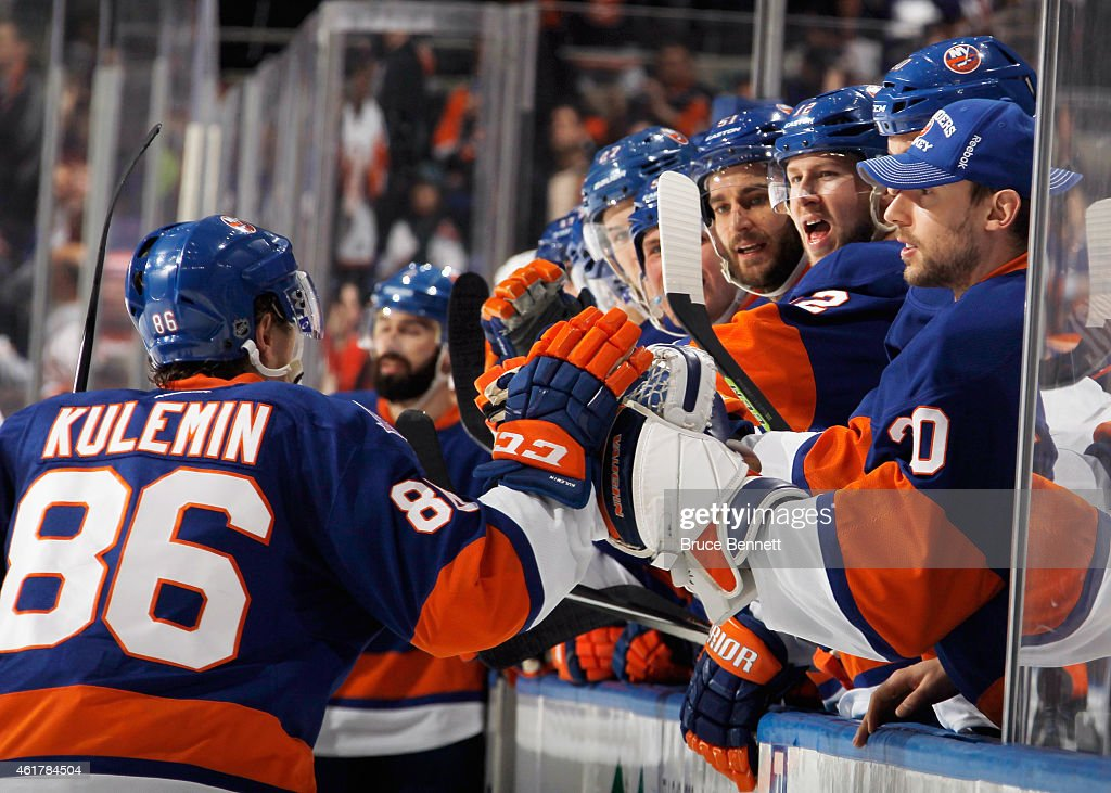 Nikolay Kulemin and the New York Islanders celebrate his second goal of the game against the Philadelphia Flyers while shorthanded at 453 of the...