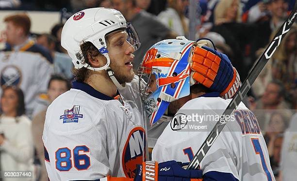 Nikolay Kulemin and Thomas Greiss of the New York Islanders celebrate their 21 victory over the Buffalo Sabres in an NHL game on December 31 2015 at...