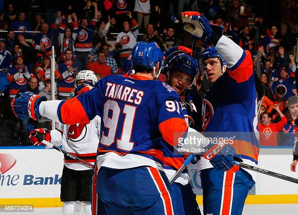 Nikolay Kulemin of the New York Islanders celebrates his first period goal with teammates John Tavares and Kyle Okposo against the New Jersey Devils...