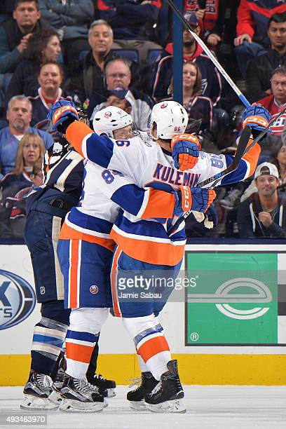 Nikolay Kulemin of the New York Islanders celebrates his first period goal with teammate Mikhail Grabovski of the New York Islanders during a game...