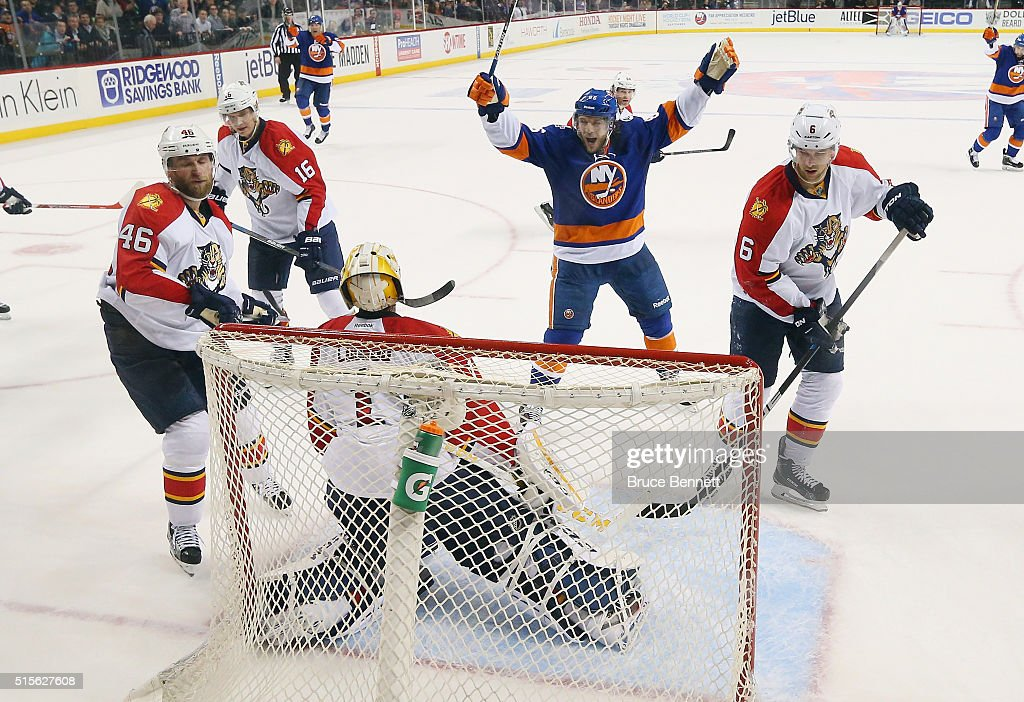 Nikolay Kulemin #86 of the New York Islanders celebrates the game winning goal by <a gi-track='captionPersonalityLinkClicked' href=/galleries/search?phrase=Cal+Clutterbuck&family=editorial&specificpeople=570497 ng-click='$event.stopPropagation()'>Cal Clutterbuck</a> #15 against <a gi-track='captionPersonalityLinkClicked' href=/galleries/search?phrase=Roberto+Luongo&family=editorial&specificpeople=202638 ng-click='$event.stopPropagation()'>Roberto Luongo</a> #1 of the Florida Panthers at the Barclays Center on March 14, 2016 in the Brooklyn borough of New York City. The Islanders defeated the Panthers 3-2.