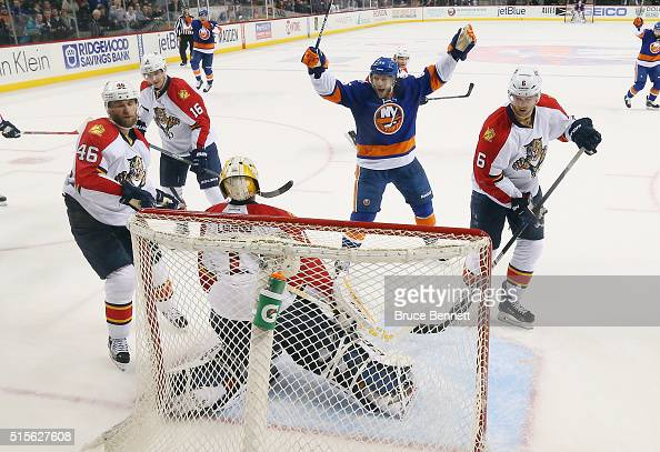 Nikolay Kulemin of the New York Islanders celebrates the game winning goal by Cal Clutterbuck against Roberto Luongo of the Florida Panthers at the...