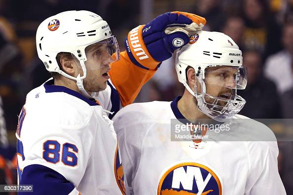 Nikolay Kulemin of the New York Islanders celebrates with Dennis Seidenberg after scoring against the Boston Bruins during the second period at TD...