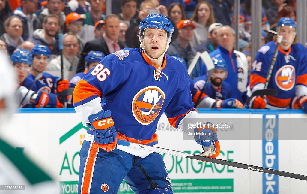 Nikolay Kulemin of the New York Islanders in action against the Minnesota Wild on March 24 2015 at Nassau Veterans Memorial Coliseum in Uniondale New...