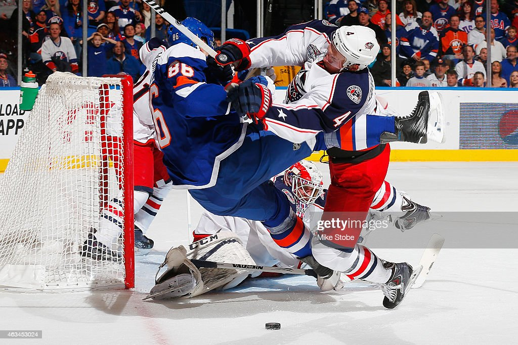 Nikolay Kulemin #86 of the New York Islanders is checked in front of the goal by <a gi-track='captionPersonalityLinkClicked' href=/galleries/search?phrase=Kevin+Connauton&family=editorial&specificpeople=6271014 ng-click='$event.stopPropagation()'>Kevin Connauton</a> #4 of the Columbus Blue Jackets at Nassau Veterans Memorial Coliseum on February 14, 2015 in Uniondale, New York.