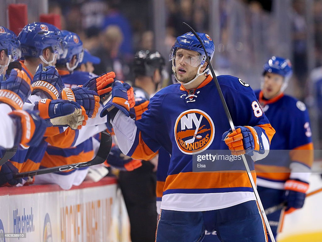 Nikolay Kulemin of the New York Islanders is congratulated by teammates on the bench after he scored in the third period against the Nashville...